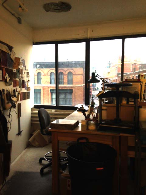 private bench for rent in a shared bindery space