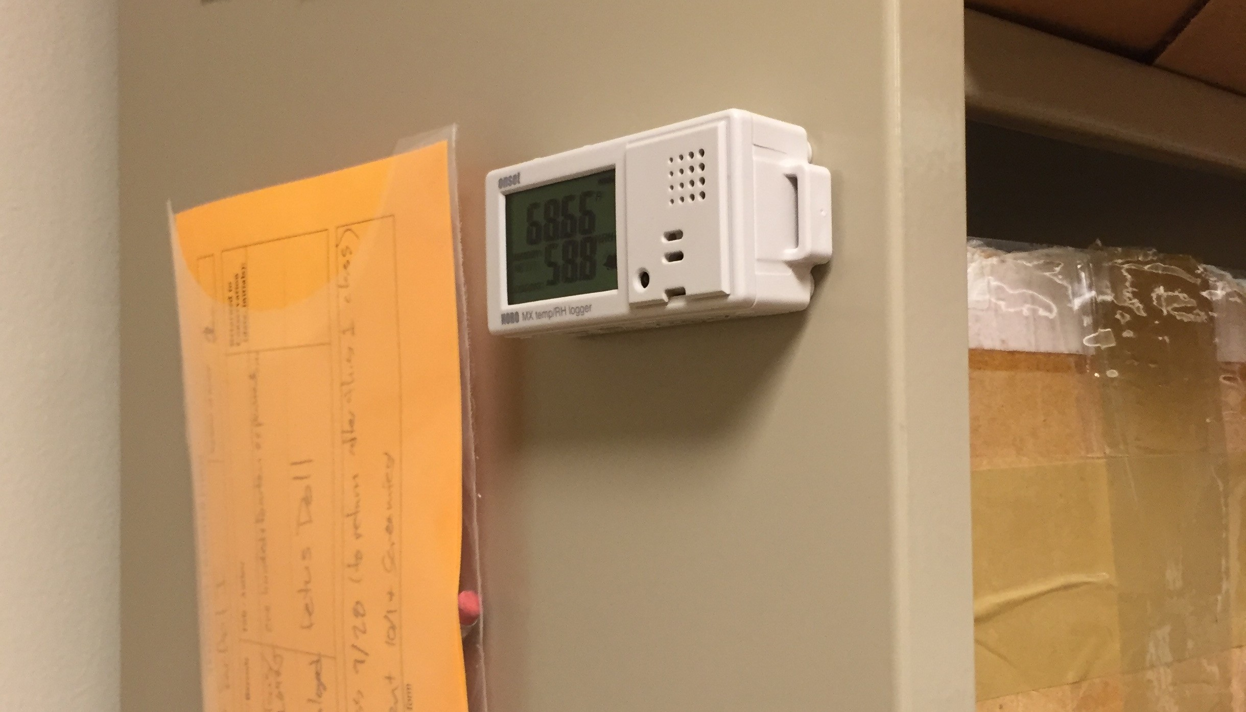 The magnets make this data logger easy to mount on nearby metal surfaces, like library shelving.