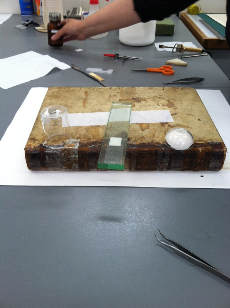 Left to Right: a solvent chamber, direct application of solvent-soaked blotter to tape, plaster chamber.